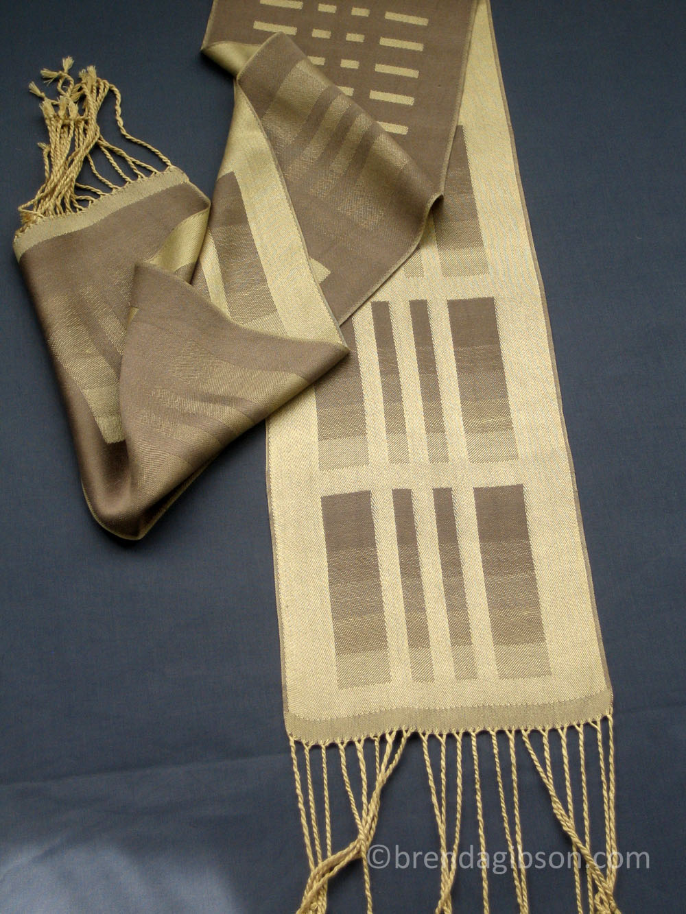 Silk scarf in shaded satin, gold/taupe. £150.00